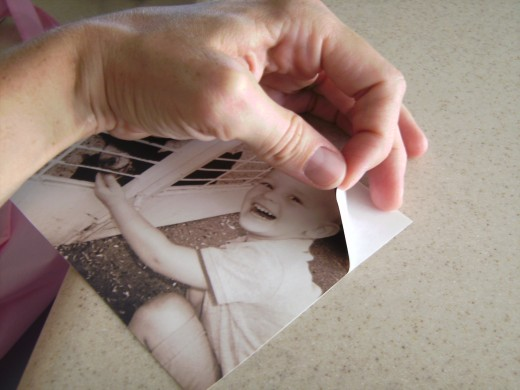Be careful when peeling the paper off the back of the photo