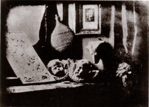 Daguerreotype Daguerre Atelier 1837.  Interesting, as it is one of the first photos.