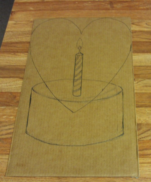 I sketched out the design for my painting on card board.