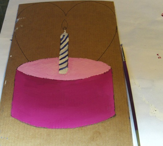 I used blue and white tempera and acrylic paints to create the birthday candle on the cupcake.