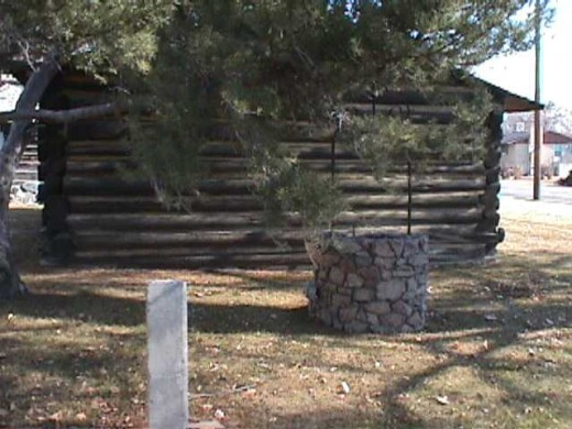 Early pioneer home, well, and a relic from the Nauvoo Temple, Nauvoo, Illinois