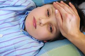 Flu symptoms include a high fever and extreme body aches.