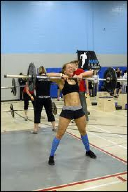 Deadlift high pull with barbell; now substitute the resistance bands. Pull from the ground.