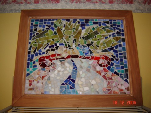 stained glass abstract of woman laying on a couch