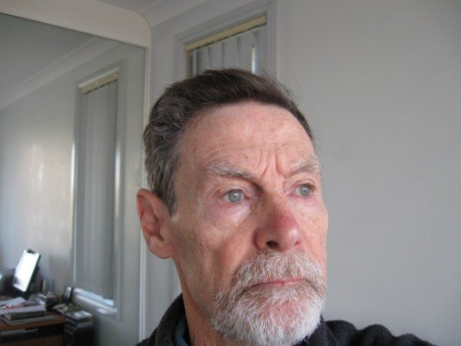 Yes, that's a self-portrait of me taken a arms length.  The beard doesn't help.  My wife insisted I shave it off.