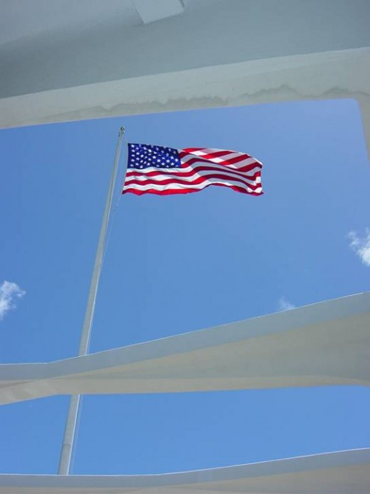 U.S. Flag flying over the USS Arizona Memorial
