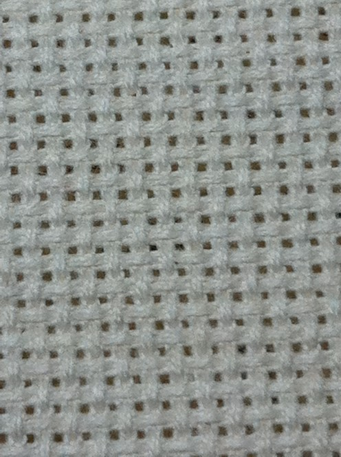 "As you can see Aida Cloth has a very even weave to it and the spaces of ""holes"" between the weave are quite easy to see."