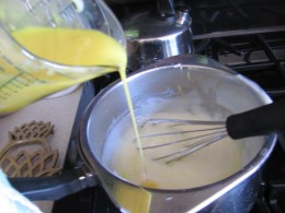 adding yolks to pudding mixture