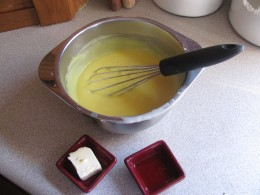 adding butter and vanilla to pudding mixture
