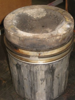 Piston showing detonation damage.