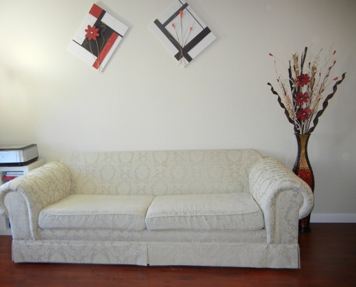 When I placed the sofa there, it seemed a bit too bare/plain to me. It didn't carry out the theme.