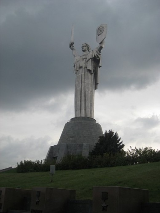 Motherland statue in Kiev which is part of a war museum on the banks of the Dnipro River. The statue is 335 feet tall (102 m)! See how the sword looks like it's chopped off midway? It is! - since it was higher thank the cross of the tallest church