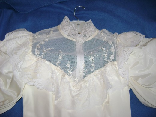 close-up of bodice: lace and ruffles