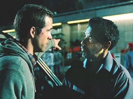 Ryan Reynolds as Matt Weston and Denzel Washington as Tobin Frost