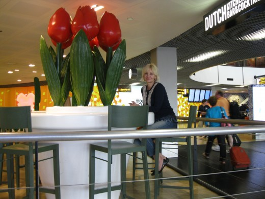 Amsterdam Airport Schiphol - relaxing at a table in one of the cafe's