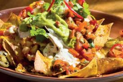 Beef nachos with guacamole, sour cream and tomato salsa