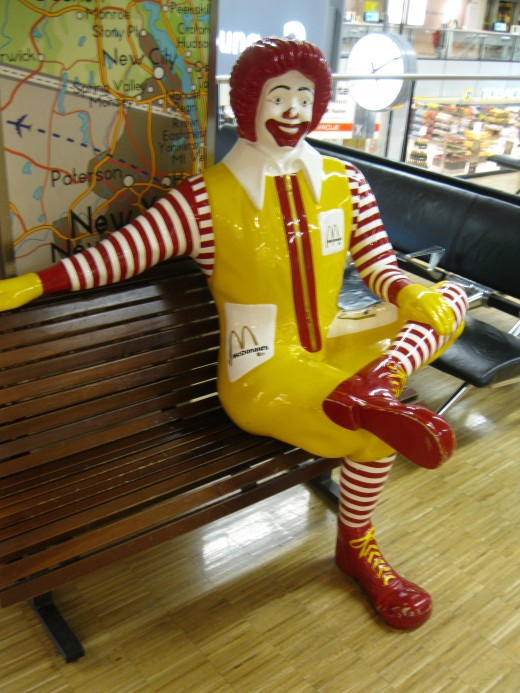 Amsterdam Airport Schiphol - Ronald McDonald relaxing on a chair outside his restaurant