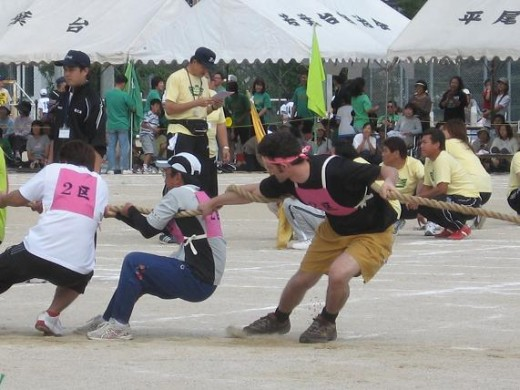 Tug-O-War is a popular sports day game. Notice the team colours (pink in this case)