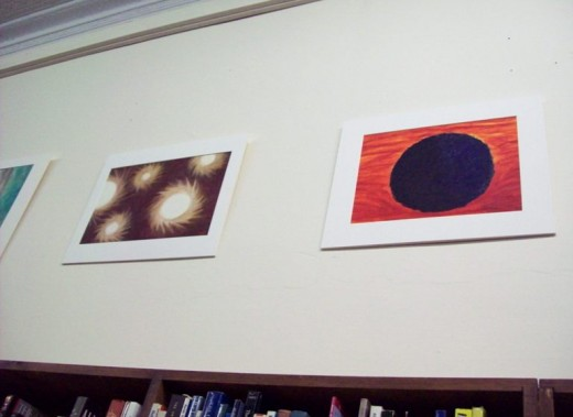 "Reese: ""A New Day"" - oil on paper, 2012 beside her aforementioned work, ""Black Hole: Summer"""