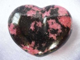 A heart carved out of Rhodonite