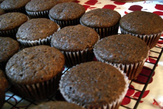 Unfrosted chocolate cupcakes.