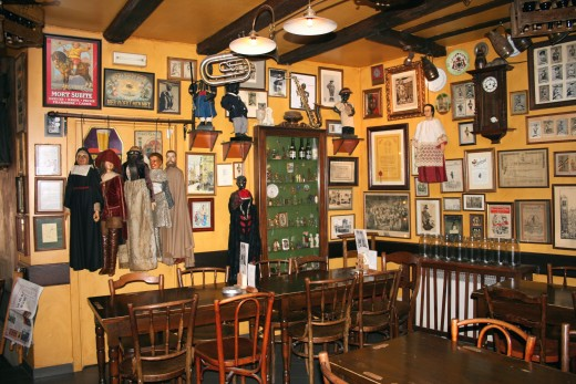 Interior of Poechellekelder Bar with Mannekin Pis costumes, dummies and paraphenalia.