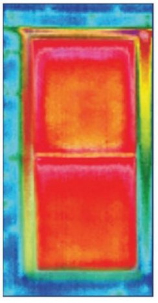Infrared image of the heat loss through a window - how much money are you losing by heating the outdoors?