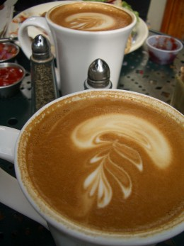 Two lattes with artistic swirls