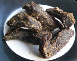 A plate of tasty homemade biltong. You can chew on a stick of biltong or it is more widely eaten in thin slice....
