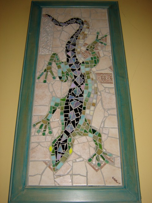 3-D mosaic.  Lizard is made of stained glass surrounded by cermaic.  When you look at it, you get the illusion of seeing the lizard THROUGH a hole in the wall...freaky!