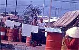 US Soldiers cutting the tops off AGENT ORANGE barrel's to use them for latrine duty, fill with dirt and use for protection against enemy fire, BAR-B-Q pits and various tasks.