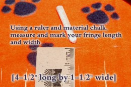 The fringe strips measure 4-1/2'' long, and 1-1/2'' wide. Measure all four sides and then begin cutting the sections.