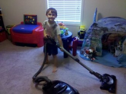 My proof that a 6 year can vacuum with a smile!
