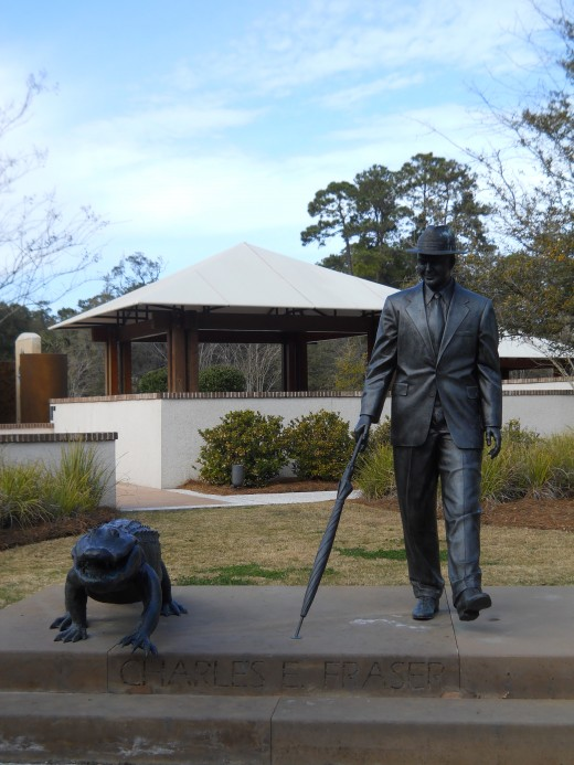 Statue of Charles Fraser walking with an alligator.