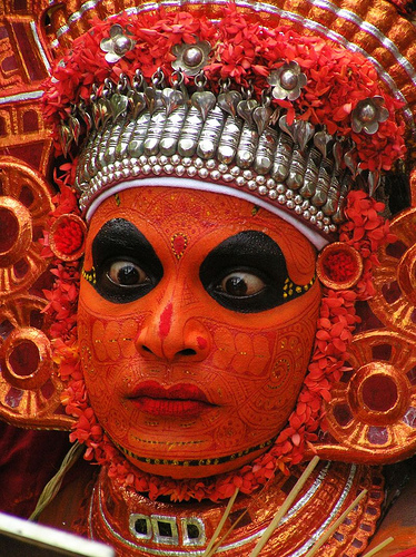 "Painted face of a ""theyyam"" in Malabar, Kerala,India"