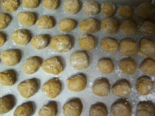 Coconut-Peanut Butter balls formed about the sized of an English Walnut and ready to be frozen