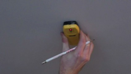 Use a stud finder to locate any studs in the area where you want to hang your heavy bag.