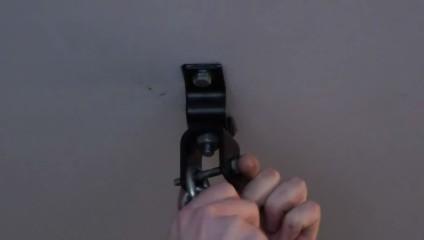 Run the bolt through the eye of the heavy bag chain.