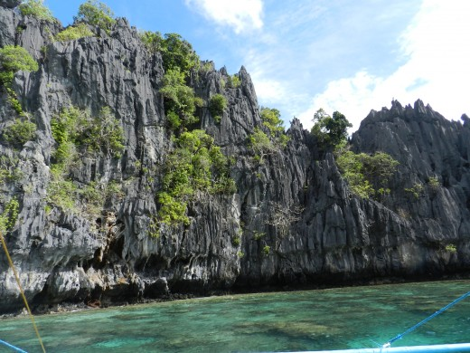 One gets to swim in these crystal clear waters with a smaller lagoon reached through an archway of stone.