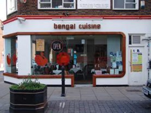 The Bengal Cuisine at No 12. Unsuspecting tourists beware, you could be sitting in a dead girl's seat if you choose the No 13 curry house instead. Creepy!