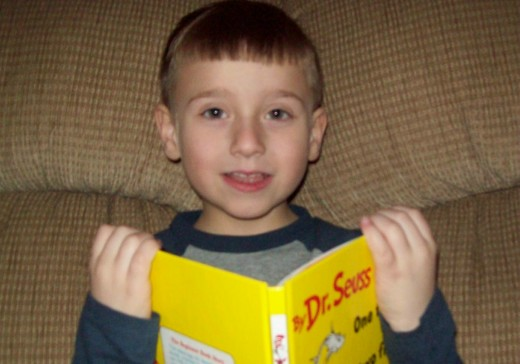 AJ with one of his favorite rhyming books