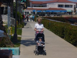 Talking about good memories and the deep love shared by family members is a way to help young children cope with grief. My son, aged six months, enjoys a stroll with his Great Grandma. These happy memories helped him through the grieving process.