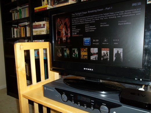 Rent movies from the iTunes store and watch on your television with an Apple TV. The Apple TV receiver is the small black device under the right side of the tv (about the size of a deck of cards).