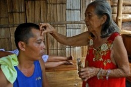 An albularyo doing some healing.