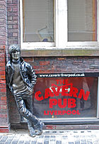 """A statue of John """"hanging out"""" in Liverpool"""