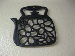 An old cast iron trivet.
