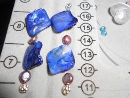 Assemble the beads into a pattern. Add 2 crimping beads at bottom and 1 at top.