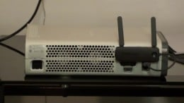 What the wireless network connector should look like after it's connected and plugged in to your Xbox 360.