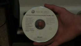 Insert the disc that came with the wireless network adapter in your Xbox 360.