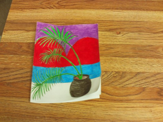 I used a blue colored pencil to shade in the water and a brown one for the planter.